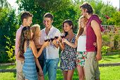 Teenagers Celebrating A Toasting With Wine