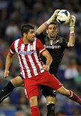 BARCELONA - OCT, 19: Diego Costa(L) of Atletico Madrid vies with Kiko Casilla(R) of Espanyol during