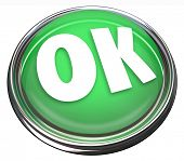 The word OK on a green round button to illustrate approval or acceptance, or beginning or starting a