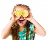 little girl with two halves of lemon as eyes isolated on a white background