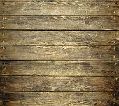 Background Of Old Worn Wooden Planks With Nails