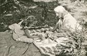 Vintage photo of mother and daughter picnicking, sixties