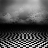 Empty, dark, psychedelic wonderland image with black and white checker floor and ray of light
