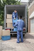 picture of moving van  - Movers unloading moving van - JPG