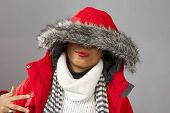 With Red Parka And Striped Scarf