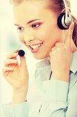 Call center woman with headset. Beautiful smiling caucasian woman