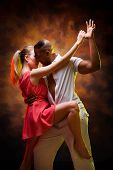 picture of samba  - Young and sexy couple dances Caribbean Salsa - JPG