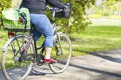 Obese woman riding a bike in spring park