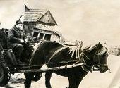 POLAND, CIRCA 1940's: Vintage photo of man on horse drawn cart