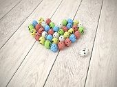 Colourful Easter Eggs Heart On White Wooden Floor