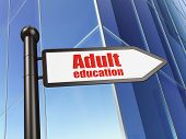 Education concept: sign Adult Education on Building background