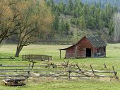 Old Wood Fence And Barn.
