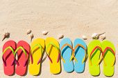 Colorful beach sandals in a row
