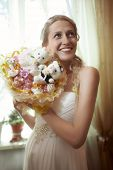 Beautiful young bride with a wedding bouquet