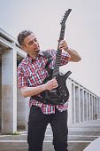 Man In Short Sleeve Shirt Playing Electric Guitar