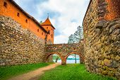 picture of turret arch  - View from inside of castle on stone walls archs and red bricks tower - JPG