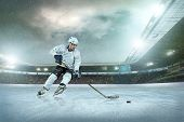 foto of skate  - Ice hockey player on the ice - JPG