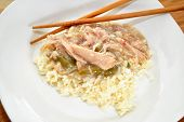 Chicken Gravy Served On White Rice With Chop Sticks