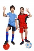 two children soccer players showing sign ok
