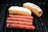 Hot Dogs And Buns On A Summer Grill