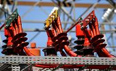 stock photo of transformer  - electrical connectors RED GREEN and yellow high voltage to the transformer - JPG