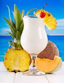 picture of pina-colada  - cocktail pina colada with fresh fruits on a beach - JPG