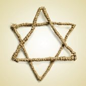 a Star of David on a beige background with a retro effect