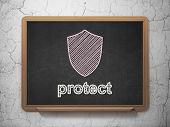 Security concept: Shield and Protect on chalkboard background