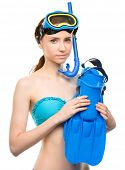Young woman with snorkel equipment, isolated over white
