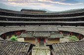stock photo of semi-circle  - Hakka Roundhouse tulou walled village located in Fujian - JPG
