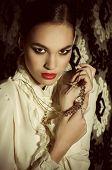 Fashion beautiful girl with jewelry precious decorations.