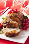 Turkey breast stuffed with apricot and red currants.