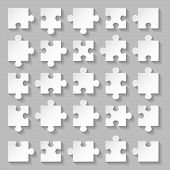 picture of riddles  - Set of blank white puzzle pieces on grey background - JPG