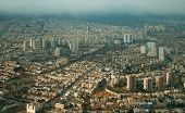 stock photo of tehran  - Aerial view of Tehran in a rainy day with ray of sunlight shining through clouds on the city - JPG