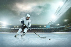 picture of winter sport  - Ice hockey player on the ice - JPG