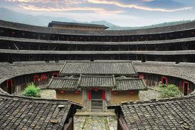 stock photo of semi-circle  - Hakka Roundhouse tulou walled village located in Fujian - JPG