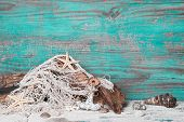 Summer, sun, beach and sea in Turquoise - wood background. Maritime decoration.
