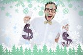 Geeky businessman holding money bags against snowflakes and fir trees in green