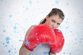 Composite image of sports woman boxing against snow falling