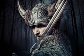 Sword, Viking warrior with helmet over vintage textured background