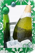 Christmas frame against two bottles of champagne chilling on ice