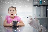 Composite image of vet holding syringe with socked girl holding kitten against snow