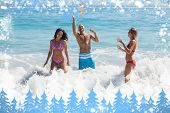 Composite image of snow frame against happy friends playing with a beachball in the sea
