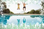 Cheerful couple jumping into swimming pool against snow