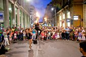 PALERMO,ITALY-SEP 14, 2014:Performer balances on a unicycle while holding torches on Sep 24, 2014 in Palermo, Italy. Palermo is the 5th most populated area in Italy and the most populated on Sicily.