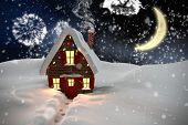 Composite image of christmas house against white fireworks exploding on black background