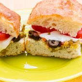 Vegetarian Hot Sandwiches With Pickle Muffaletta, Tomatoes And Melted Mozzarella Cheese
