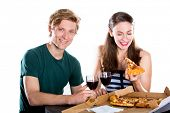Happy young couple eating pizza on a date