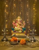 picture of pooja  - A Ganesha idol in elaborate Indian pooja set up and decoration - JPG