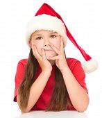 Young unhappy girl in christmas cloth, isolated over white